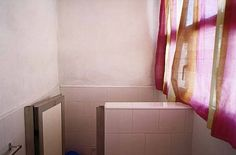 William Eggleston, UNTITLED (BATHROOM WITH PINK CURTAIN, CUBA)