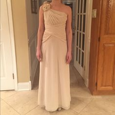 Cream color formal dress Cream color formal dress size small but was altered to a size 0. It does have some small stains if you have it dry cleaned it will look brand new ! David's Bridal Dresses Prom