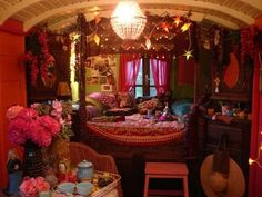 A chandelier in a gypsy caravan, thats the way to go 1st class!  Inspire Bohemia: Bohemian Bungalows and Gypsy Caravans!
