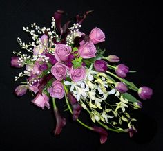 Lily of the valley, lavender roses, burgundy calla lilies, purple tulips, white dendrobium orchids, lavender cattleya orchids, ivy