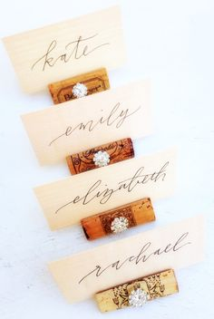 Rustic wedding Place Card Holders by KVW with gorgeous calligraphy on wood slices, by Charlie Whiskey lettering + design. Discover more unique rustic wedding decorations at www.karasvineyardweddingshop.com Cheers!