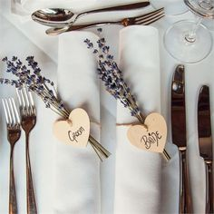 On the top table, the place names were displayed on wooden hearts which were tied to bunches of lavender. There was also homemade 'bride wedding places destination Wedding Place Names, Wedding Place Settings, Wedding Name, Wedding Places, Purple Wedding, Trendy Wedding, Wedding Lavender, Paris Wedding, Summer Wedding