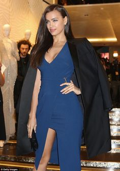 Sexy Russian bombshell Irina Shayk recently attended an opening of one of Roberto Cavalli's newest boutique shops in Milan on Saturday. The eye-catching supermodel, who fronted the cover of the fashion bible Vogue Mexico's January 2014 issue, looked ravishing in an all black and blue ensemble at the Italian designer's store launch.