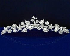 SparklyCrystal Girl Tiara Comb With Crystal Flowers and Leaves C5235 SparklyCrystal,http://www.amazon.com/dp/B000WNLH4S/ref=cm_sw_r_pi_dp_9jI0sb0Y8KS78RQ4