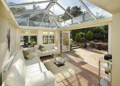 sun room design with large windows and home furnishings   Greenhouse ...