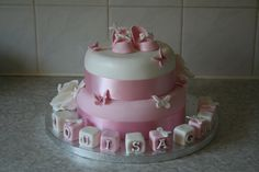 Booties and Butterflies christening cake  £110.00