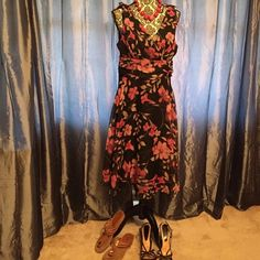 Beautiful black floral dress. Black lightweight floral dress. 14p but I am not a petite woman and it hit below my knee and perfect!  Zips up the back. Perfect to wear to work, a picnic, or dress it up for a night out! Dresses