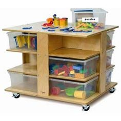 """Use as a side table?  Hold books & magazines,  etc.   $205 Preschool Mobile Cubby Tower with 12 Clear Trays, 28½""""W x 24""""D x 22½""""H, Natural"""