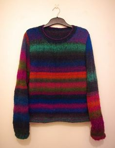 Colourful jumper knitted by Odette