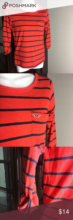 Hollister Orange And Blue Striped Mid Sleeve Shirt Women's Hollister Orange and blue striped mid sleeve shirt , very cute and in good condition size XS 