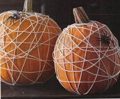 Got some yarn or string and a fake spider? You have everything you need to make no-carve spiderweb pumpkins. #Halloween