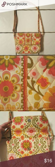 """Vera Bradley Retro Floral Crossbody Purse So adorable! Small messenger-style bag with 1"""" thick adjustable strap that is 26 1/2"""" at its longest. 8 1/2"""" long, 6 3/4"""" tall, 2"""" deep. Front flap pocket with snap, open back pocket, interior zippered pocket and 2 open interior pockets. Super cute retro style quilted floral design.  Good overall condition with clean interior and lovely exterior but there are signs of wear, particularly: 2nd pic shows a loose thread, 7th pic shows a worn area, and…"""
