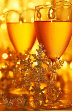 Image of 'Romantic holiday drink, celebration of Christmas or new year eve, party with Champagne and festive gold ornament lights decoration'