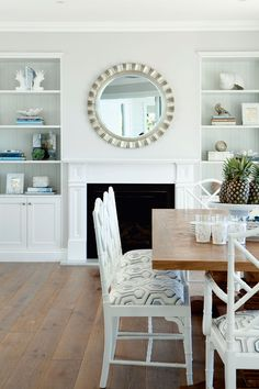 House of Turquoise: Verandah House I mirror over mantle, built ins House Of Turquoise, Cool Ideas, Dining Room Fireplace, Fireplace Ideas, Built In Bookcase, Bookcases, White Bookshelves, Coastal Decor, Coastal Living