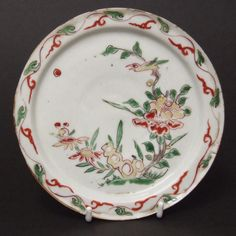 A Transitional Porcelain Dish for the Japanese Market, Tianqi or Chongzhen c.1620-1640. Decorated with a Bird on a Branch of a Tree Peony Next to a Scholars Rock.