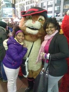 Dasia and her mommy pose with Puss in Times Square