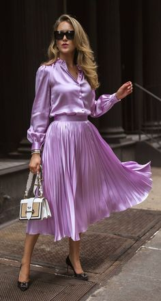 // Lilac silk button-up blouse with puff shoulders and blouson sleeves + matching lilac pleated satin midi-skirt, cat-eye acetate sunglasses, stacked statement gold bracelets, pointy-toed pu Skirt Outfits, Dress Skirt, Dress Up, Lilac Dress, Manolo Blahnik, Bluse Outfit, Satin Midi Skirt, Pleated Skirts, Pencil Skirts