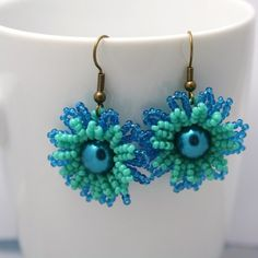 #beadwork #earrings #jewelry  http://folksy.com/items/1842669-Double-Layer-Flower-Earrings-Turquoise-and-Teal