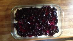 Blueberry Desert - 1 1/2 C flour, 1 1/2C ch pecans, 1 1/2 sticks melted butter. Mix well and press into bottom of greased 9x13 dish. Bake @ 350 for 30 min. While that's baking, mix 8 oz Cool Whip, 1-8 oz softened cream cheese and 1 C confectioners sugar. When crust is cooled, pour mixture on top. Pour a can of blueberry pie filling in top and put in fridge to cool until ready to eat.