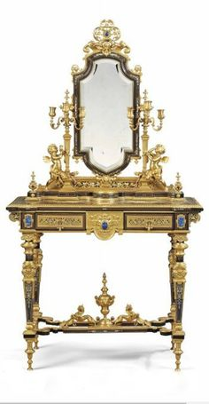 A NAPOLEON III ORMOLU AND LAPIS LAZULI-MOUNTED IVORY, COPPER AND PEWTER-INLAID EBONY DRESSING TABLE ATTRIBUTED TO FERDINAND BARBEDIENNE, PARIS, CIRCA 1870