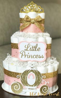 The Posh Toosh Specialty Diaper Cakes make perfect baby shower centerpieces and décor, baby shower gifts, nursery décor, and a unique and practical gift for a mommy-to-be! 3 Tier Pink and Gold Little Princess Diaper Cake with Royal Carriage and Tiara