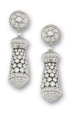 A pair of diamond pendent earrings, by Graff The concicle drops of graduating tassle design set throughout with brilliant-cut diamonds, between horizontal rows of square and brilliant-cut diamonds detail, the surmount designed as a circular plaque of brilliant-cut diamonds, mounted in 18k white gold, signed Graff.