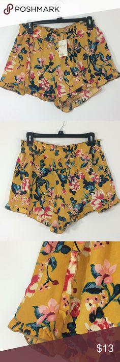 "NWT Living Dolls yellow/floral w/ruffle shorts-SzL Trendy feminine shorts by Living Dolls. NWT Sz L. Elastic waist with ruffle trim. Ruffled hem. 🌸Lovely! Waist across before stretch 14.5"" with stretch to 19"" Waist to hem 12"" Living Dolls Shorts"