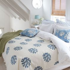 Coastal bedroom with coral print linen ~