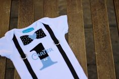 """First Birthday Onesie Baby Boy """"1"""" Mickey Mouse Baby Blue Black and White Polka Dots Little Man. $31.50, via Etsy."""