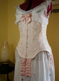 1906 replica S-bend corset in pink coutil, vintage lace, silk satin ribbon.  Pattern coming soon!