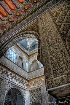 Mudejar art. Arches in a courtyard in the Alcazar, Seville, Spain