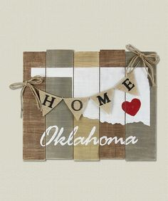 Hang your state pride on your wall with this piece of rustic, wooden wall art that shows where your heart is.
