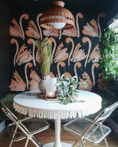 Hand painted flamingo wall by Liz Kamarul. Stunning pink flamingo designs painted onto a black wall. Bird decor at its best.