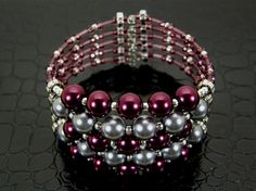 Wide Purple & Gray Pearl Memory Wire Bracelet ... I like the thick/thin look.