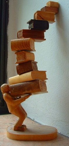 A wood statue of a reader—does this remind you of your last visit to a bookstore or library? #literaryart http://writersrelief.com/