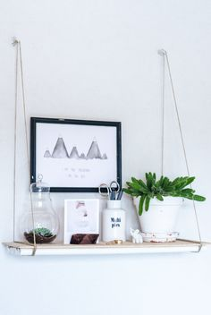 Hang a pic behind it to give the look of display w/o weighing the shelf down