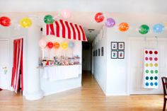 What FUN and inexpensive décor for a candy themed party. Love the red and white stripes and the balloons in plastic wrap to resemble wrapped candy.