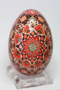 Friday Egg today is a traditional rose or star design executed on a goose egg. I love the color combination of scarlet and dark red. It...