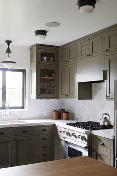 marble backsplash/ painted cabinets / lighting