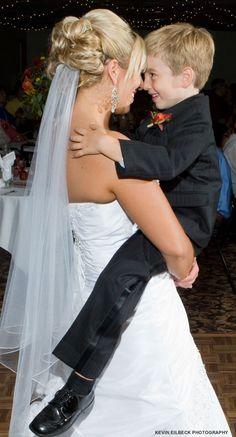 Bride holds ring bearer for a dance