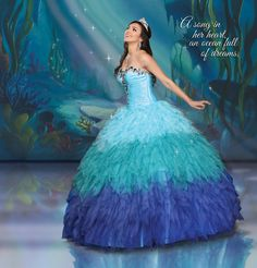 Disney Royal Ball Collection Cascasing waves of ruffles and oceans of jewels pay tribute to Ariel's courageous yet free-spirited nature. Style: 41061 Fabric: Taffeta+Tulle Color: Aqua/Teal/Royal, Purplish/Cerise/Bubblegum, Peony/Orange/Fuchsia, White/Silver/Black