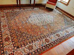 Found on EstateSales.NET: Nice large floor rug in orange and blue