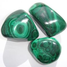 """Malachite; A """"stone of transformation"""". Assists in coping with setbacks, challenges & changing situations. Aids in releasing negative emotional experiences. Helps to intuit answers, to create an unobstructed path & to identify the steps needed to attain desired result. Brings loyalty in love, friendships and partnerships."""