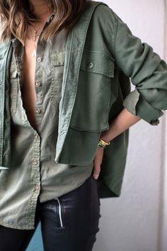 olive jacket and button up, black leather pants