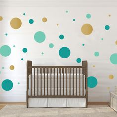 "These fun multi-size polka dot decals are the perfect addition to any kids room, playroom, nursery, living room, or bedroom. One order includes 48 multi-size dots in 3 colors 12"" dots - Qty:9 (3 of each color) 5"" dots - Qty:18 (6 of each color) 2"" dots - Qty:21 (7 of each color) Please select your three color choices below. Various Dimensions: 12 inches by 12 inches 5 inches by 5 inches 2 inches by 2 inches This design is also available in 1 color."