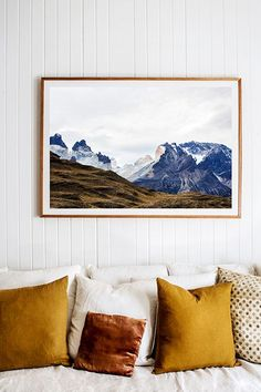 'Torres del Paine' Photographic Print by Kara Rosenlund. This is one of my favourite vistas from the collection. The unexpected blue hues of the mountains with the golden tones of the pampas grasslands below, which are cross lit by the west facing sun setting, to exaggerate the rocky crevasses. ©️️ Kara Rosenlund Shop here: http://shop.kararosenlund.com/torres-del-paine-photographic-print/