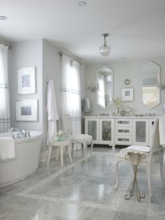 Cool and chic, this spa-like master bathroom designed by Sarah Richardson of HGTV's Sarah's House mixes soft green marble with other nature stone elements. A pair of sleek hexagonal mirrors hang above a custom double vanity while a freestanding tub brings a contemporary feel to the space.