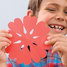 Create a flurry of Valentine decorations with this easy, heart-filled paper-snowflake technique.  http://familyfun.go.com/valentines-day/valentines-day-crafts-gifts/all-valentines-day-crafts/heart-flakes-973681/