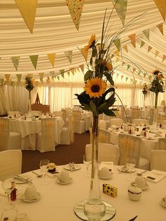 this bunting is great, i could make this but instead of green we have shades of blue and it just go around the out side of the room with helium yellow, white and blue balloons in the corners using jam jars as weights for the balloons with flowers in or metal buckets :D