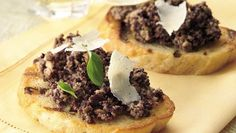 Mushrooms and olive top toasted bread slices in a tasty appetizer you can have ready in 20 minutes.